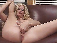 Beautiful blonde with big tits masturbating
