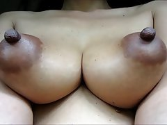 Long Puffy Nipples On Huge Tits Close Up