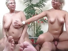 Mature couples having group sex