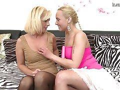 Mature lesbian milf seduces girl